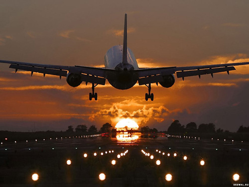 самолет солнце облака фото